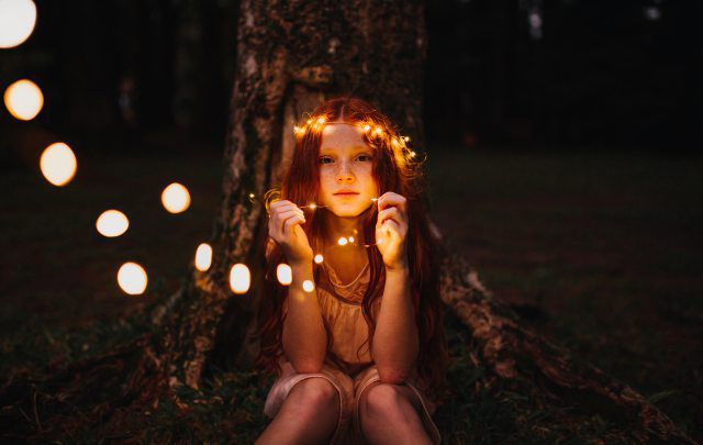 Red headed child with faire lights in hair | Fall activities in chicago