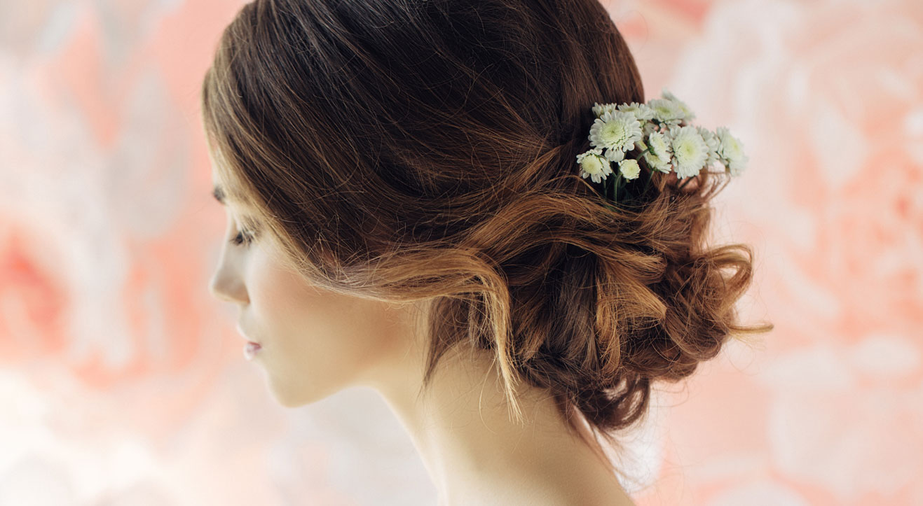 girl with bridal updo with flowers in her hair