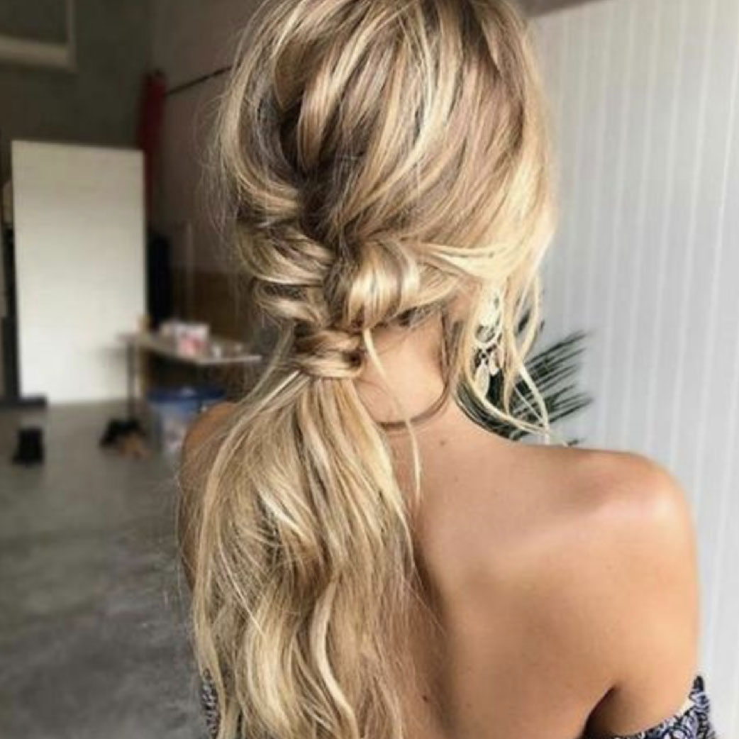 blonde hair girl styled into fancy pony tail
