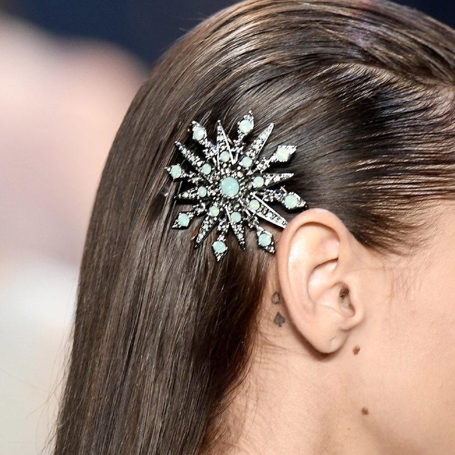Decorative barrette in slicked back hair