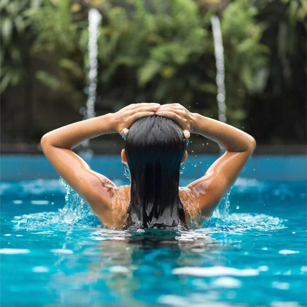 Woman in pool with long black hair