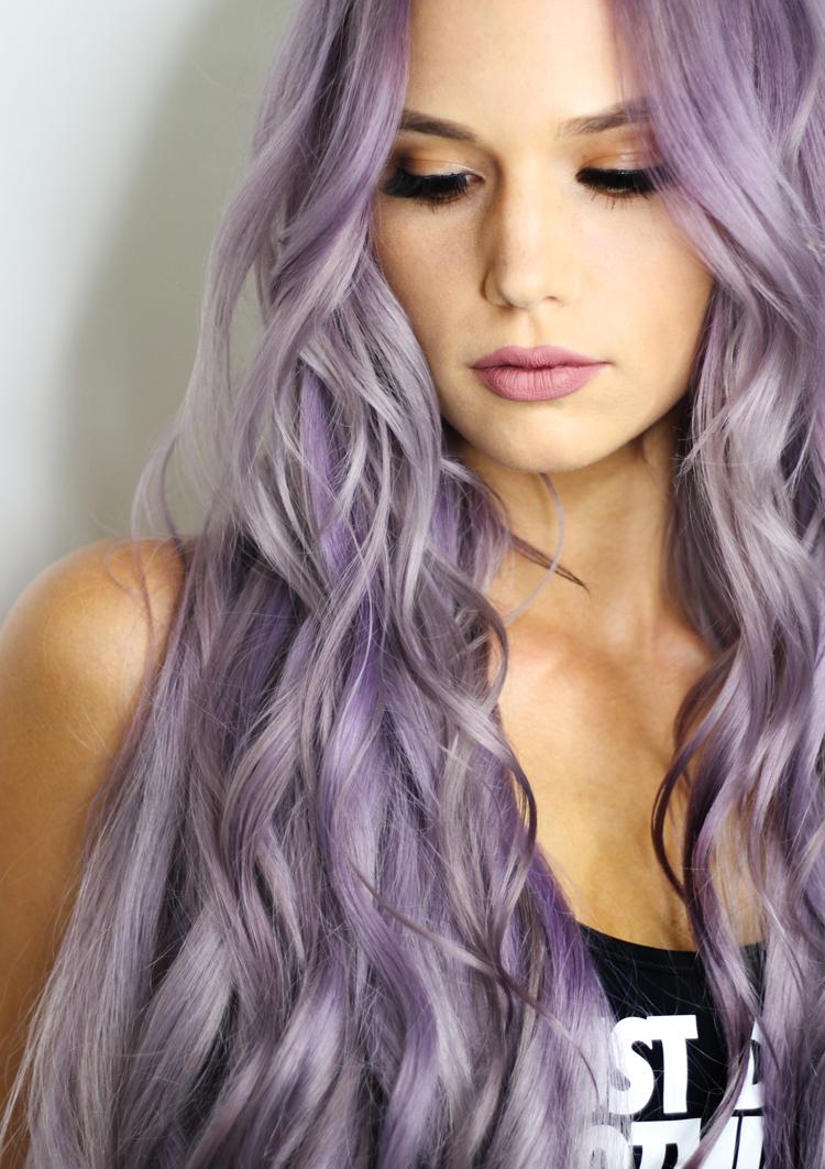 Woman with long, purple, wavy hair